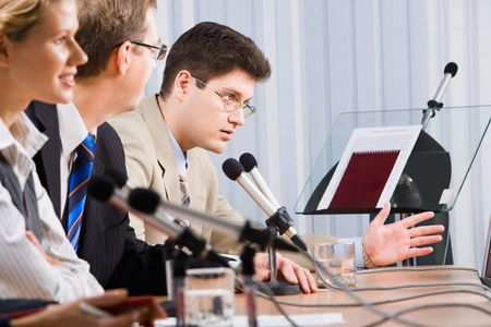 Photo of business man sitting at the table and talking during a conference  Stock Photo - 2913212
