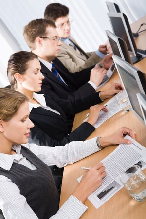 Mature students studying an educational material at training Stock Photo - 2913304