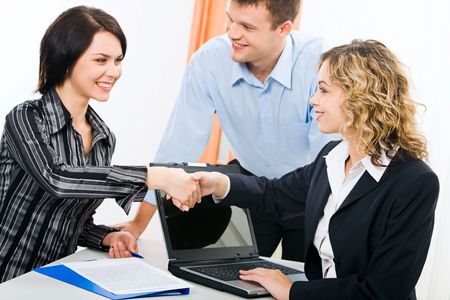 businesswear: Photo of business women shaking hands at meeting