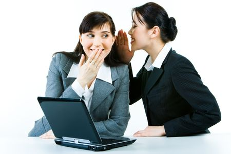 Image of business woman telling a secret to another  Stock Photo - 2913205