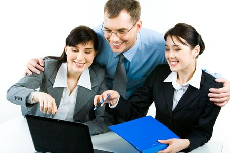 Photo of successful businesspeople looking at the laptop screen with smiles while two ladies pointing at it Stock Photo - 2913285