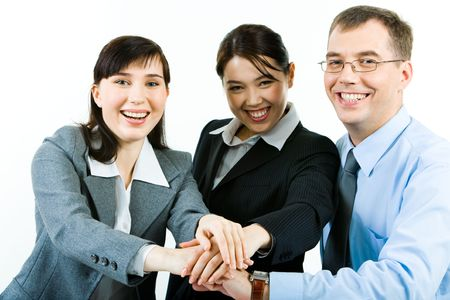 coalition: Portrait of three business partners making pile of their hands and looking at camera with smiles Stock Photo
