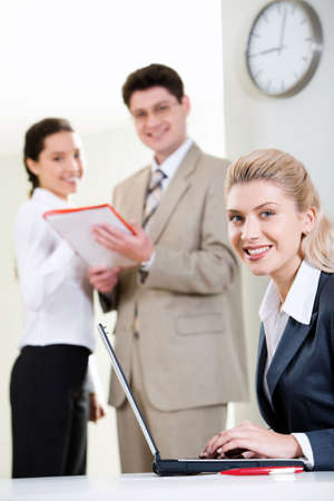 Portrait of representative woman on the background of her business team Stock Photo - 2920023