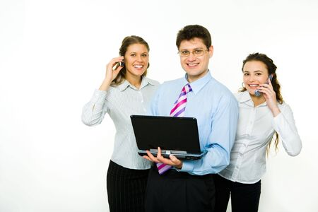 Portrait of confident man with two business women near by calling by phones   photo