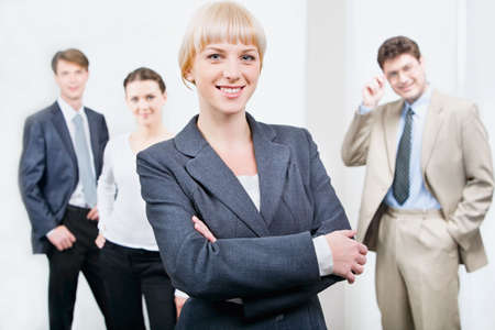 Photo of beautiful female leader on the background of her business team Stock Photo - 2924407