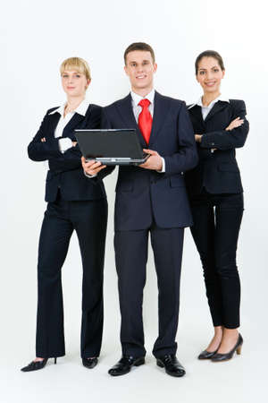 Portrait of three confident business partners standing next to each other and looking at camera photo