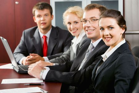 new strategy: Four confident specialists gathered together for discussion of new strategy of business