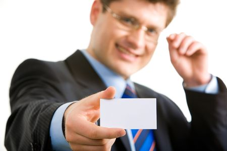 Portrait of confident businessman touching his glasses and stretching his arm with blank visiting card photo