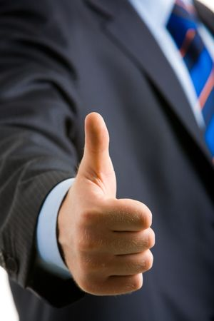 man's thumb: Closeup of happy man�s hand holding his thumb up after making a successful deal Stock Photo