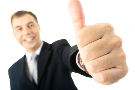 Businessman showing thumb up as a sign of successful deal photo