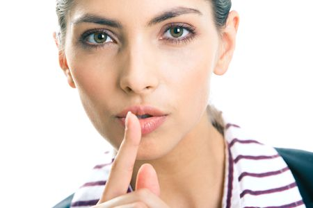 Portrait of young business woman with the finger near her lips Stock Photo - 3021268