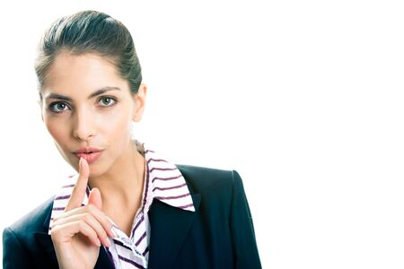 Image of business lady in suit holding her finger near the mouth Stock Photo - 3021267