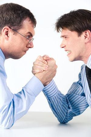 male arm: Conceptual photo of business competition: two businessmen wrestling with aggressive expression on their faces Stock Photo