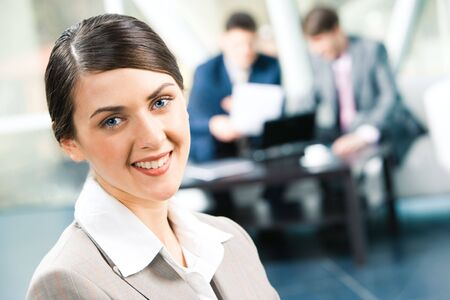 Image of beautiful business woman looking at camera in a working environment    Stock Photo - 3021274