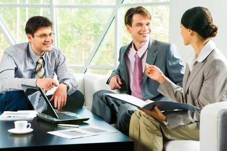 Image of successful business team discussing a new project at meeting  photo