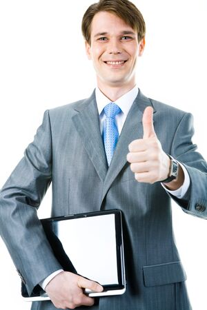 Portrait of happy businessman holding the laptop and showing sign of okay  photo