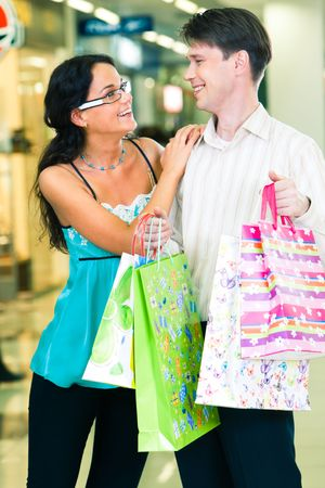 Photo of young man and woman standing in the trade centre and looking at each other happily Stock Photo - 3039151