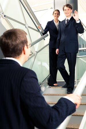 Portrait of business people looking each other and greeting at stairs in the office building Stock Photo - 3048509