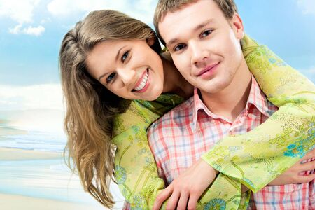 free background: Photo of happy embracing couple on the background of blue sky Stock Photo