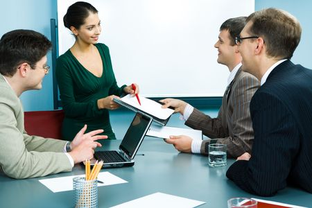 Photo of friendly business team working in the office around the table Stock Photo - 3052283