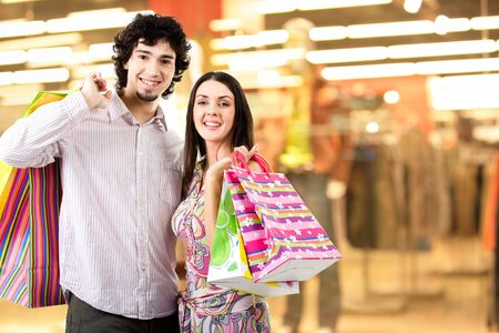 Photo of two people standing on the background of department and looking at camera Stock Photo - 3072704