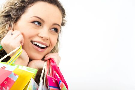 Close-up of smiling shopper�s face isolated on white background photo