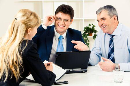 people communicating: Photo of three successful business people communicating at working meeting