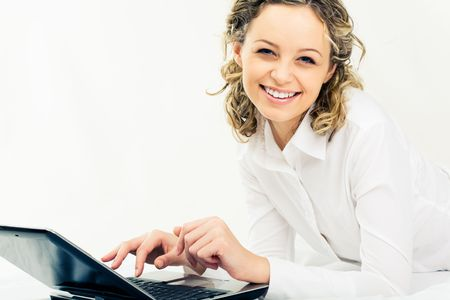 Portrait of happy businesswoman with laptop near by looking at camera Stock Photo - 3091393