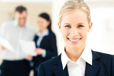 Face of successful business woman looking at camera with smile photo