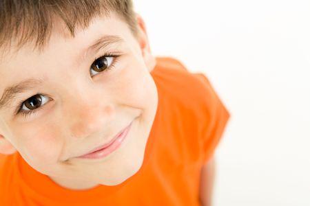 Photo of adorable young boy looking at camera