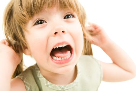 screaming face: Image of young girl screaming on a white background  Stock Photo