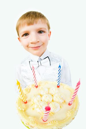 Portrait of smiling child holding the big tasty cake    photo