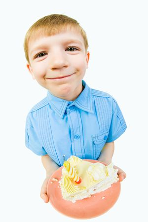 fare: Portrait of little boy with cake in hands looking at camera over white background Stock Photo