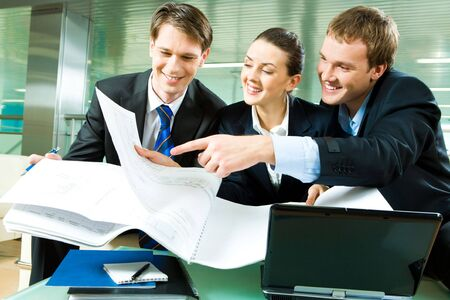 Group of business people looking at new plan and discussing it in the office with smiles Stock Photo - 3107699