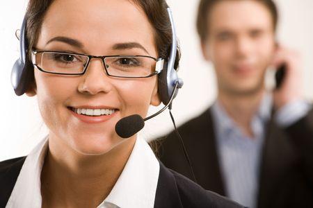 secretary phone: Portrait of responsible operator on the background of businessman