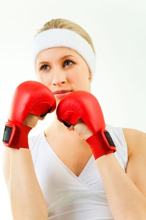 tanktop: Photo of sporty blond wearing red boxing gloves and white tank-top looking aside Stock Photo