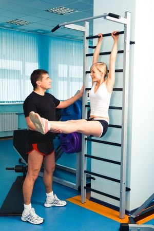 Image of woman raising the legs with man assisting her Stock Photo - 3115707