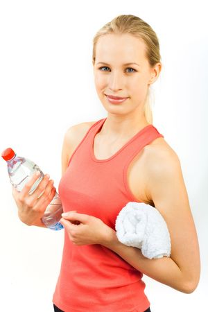 Portrait of sports girl holding the towel and the bottle of water  photo