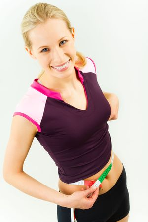 Portrait of slender woman measuring her waist and smiling  Stock Photo - 3118040