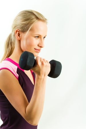 Portrait of strong girl lifting black barbell on a white background  Stock Photo - 3118023