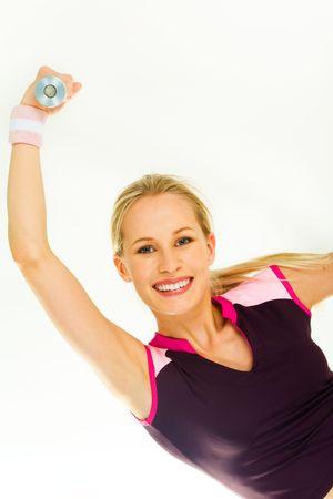 Image de la femme blonde, souriante élever sa main avec haltères Banque d'images - 3118022