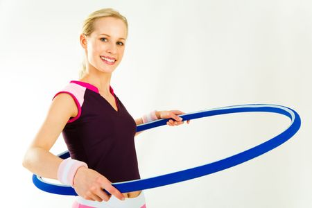 twisting: Horizontal image of young woman ready for twisting hoop