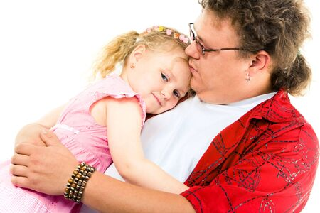 peacefulness: Image of little girl in her father's arms expressing peacefulness