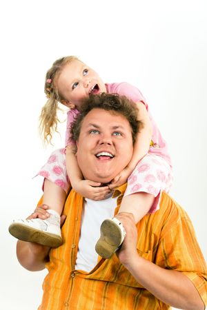 Portrait of small girl sitting on her father's shoulders while both looking aside and upwards photo
