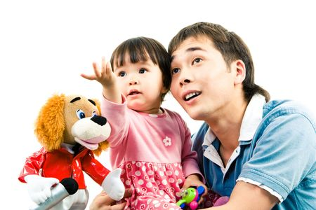 cuteness: Photo of father and child watching at something with cute toy near by