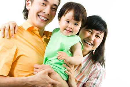 Portrait of happy family:  father, mother and their daughter