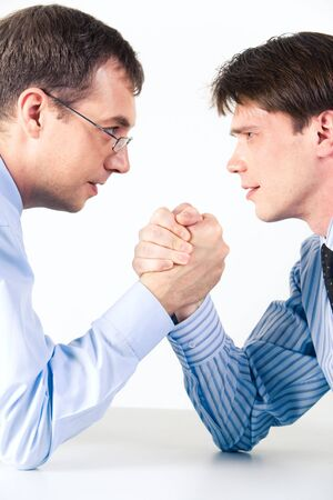 contestant: Conceptual photo of business competition: two businessmen wrestling with aggressive expression on their faces Stock Photo