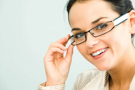 Face of gorgeous business woman touching her glasses photo