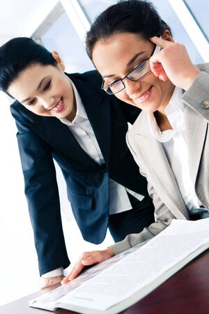 Portrait of business women discussing a working plan  photo