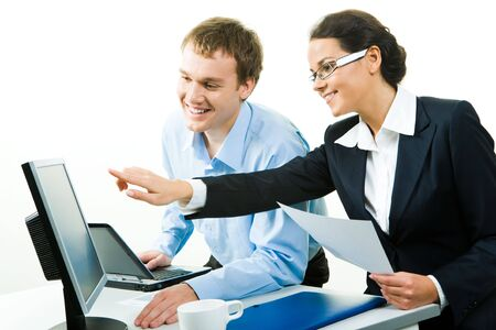 explain: View of businesswoman pointing at computer explaining business-plan to her colleague  Stock Photo